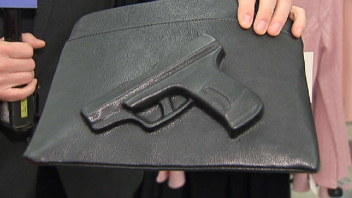Easy Pickins Job Application Controversial Purse with 3 D Gun Imprint Pulled From