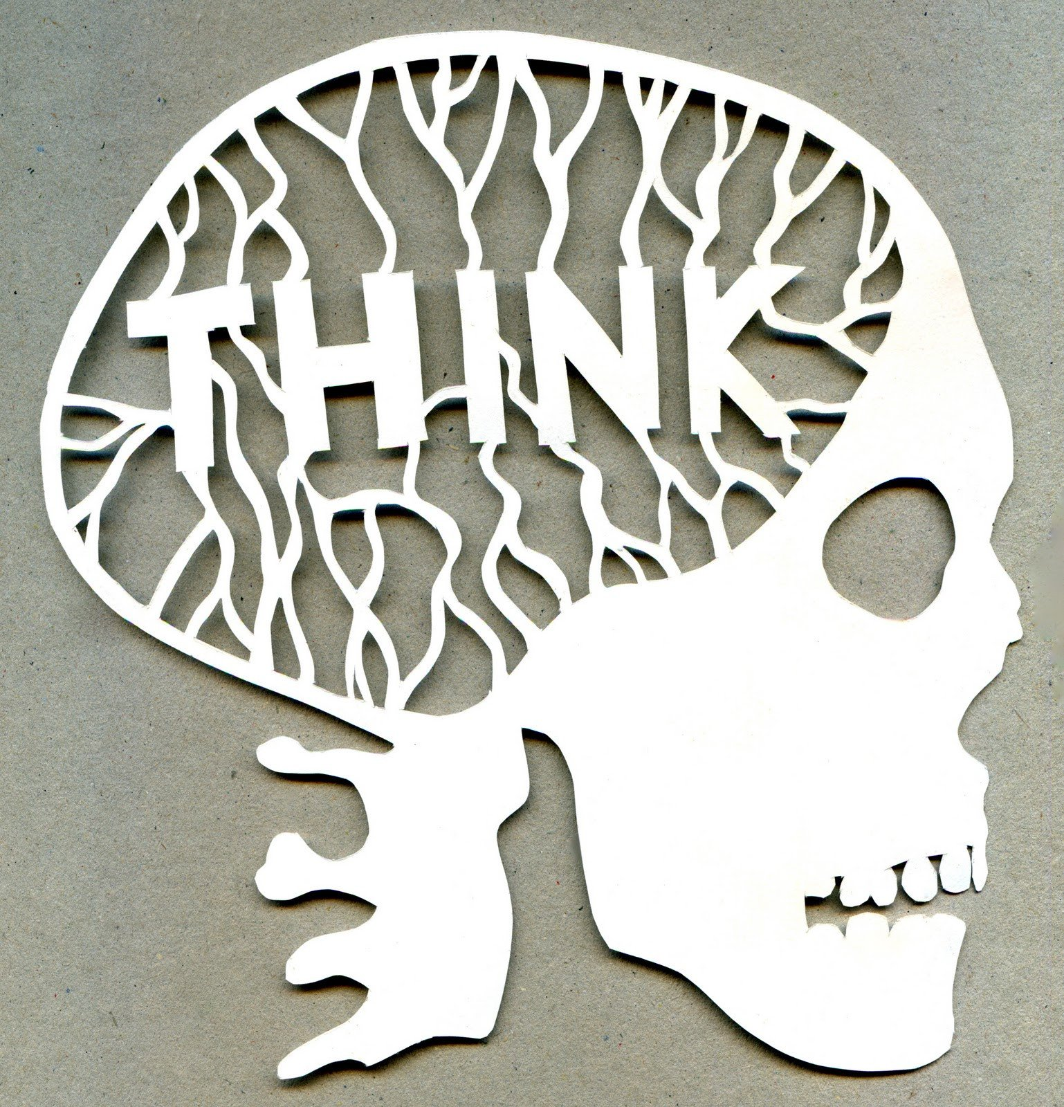 THINK paper cut out scull